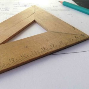 Image of a wooden set square for the Academic competition post