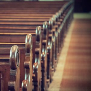 Image of a row of pews for the Do church schools provide a better education? post