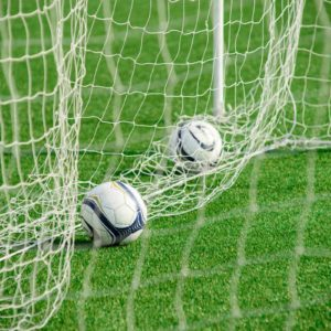 Image of footballs in a net for the Participation in school teams and events post