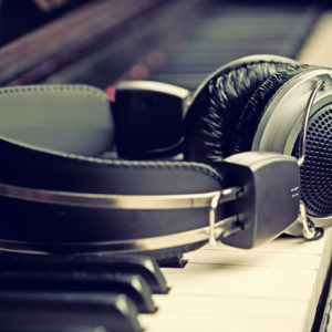 Image of an electronic keyboard and headphones for the School Arts facilities post