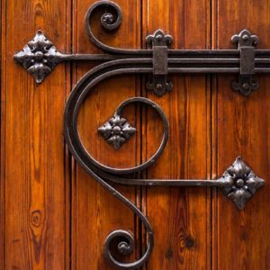 Image of an ornate door lock for the School discipline post