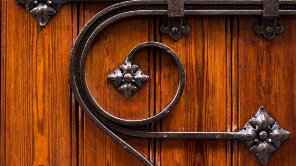 Image of an ornate door lock for the School discipline post